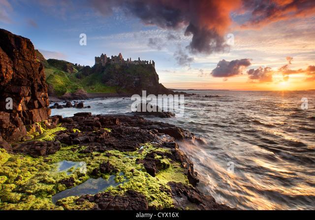 Duluce castle at sunset on the Antrim coast, Northern Ireland. - Stock Image
