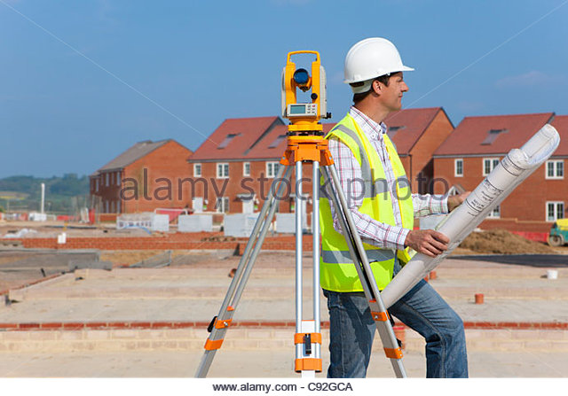 Architect with blueprints and theodolite at construction site - Stock-Bilder