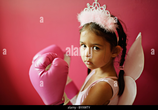 Five year old girl with pink boxing gloves, fairy wings and tiara - Stock Image