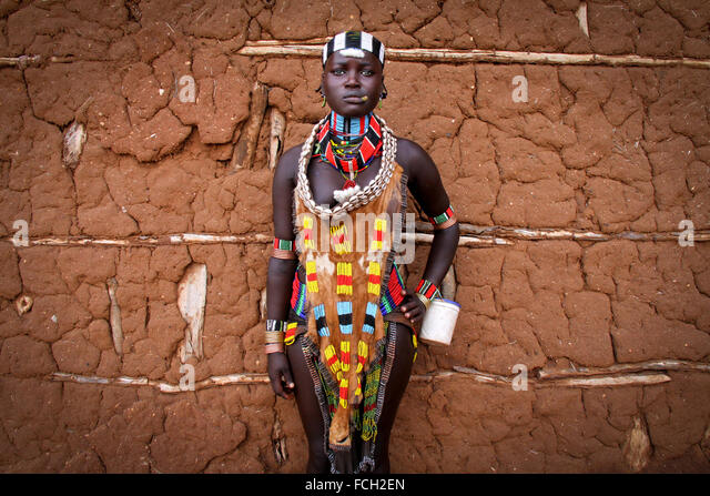 Hamer girl with traditional outfit, Turmi, Ethiopia, Africa - Stock Image