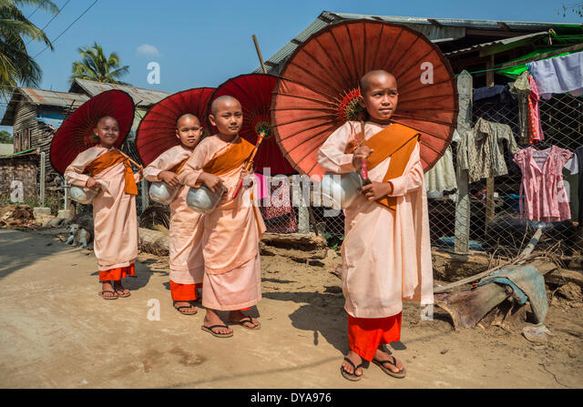 Kyauktan Myanmar Burma Asia Parade Yangon Rangoon aligned children colourful culture nuns parading pink red religion - Stock Image