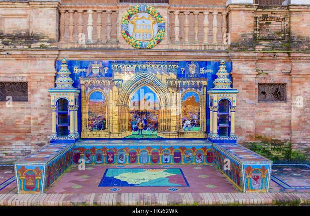 Glazed tiles bench of spanish province of Segovia at Plaza de Espana, Seville, Spain - Stock Image