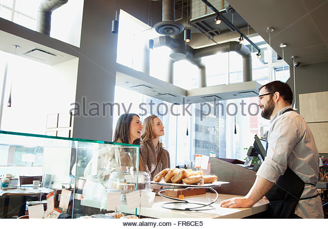 young women deciding on coffee choice - Stock Image
