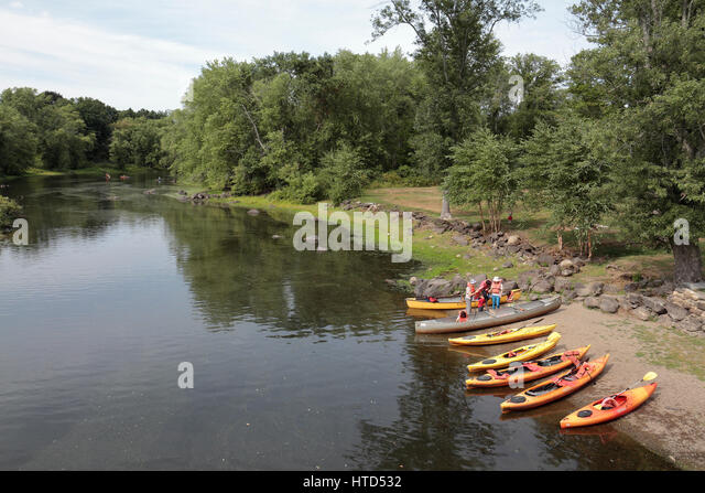 Canoeing and kayaking on the Concord River at North Bridge, Concord, MA, USA. - Stock Image