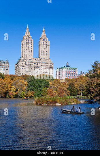 Central Park and the Grand buildings along Central Park West viewed across the lake in autumn, Manhattan,  New York, - Stock-Bilder