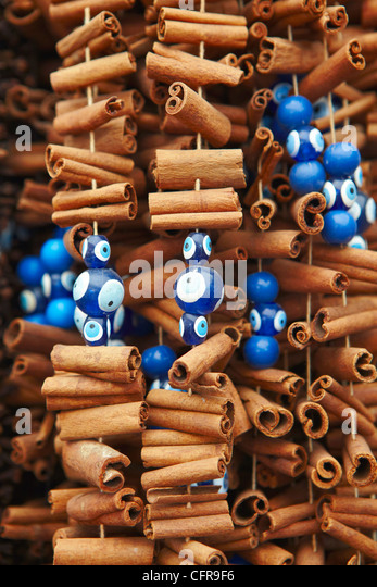 Cinnamon sticks and evil eye souvenirs, Istanbul, Turkey, Europe - Stock Image