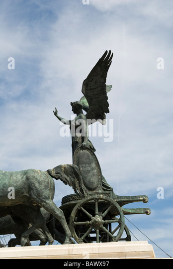 Detail of Vittorio Emanuele II Monument The goddess Victory riding on a quadriga atop the Vittorio Emanuele II Monument - Stock Image