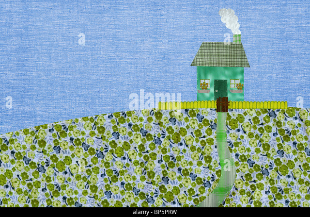 Green coloured house with picket fence - Stock Image