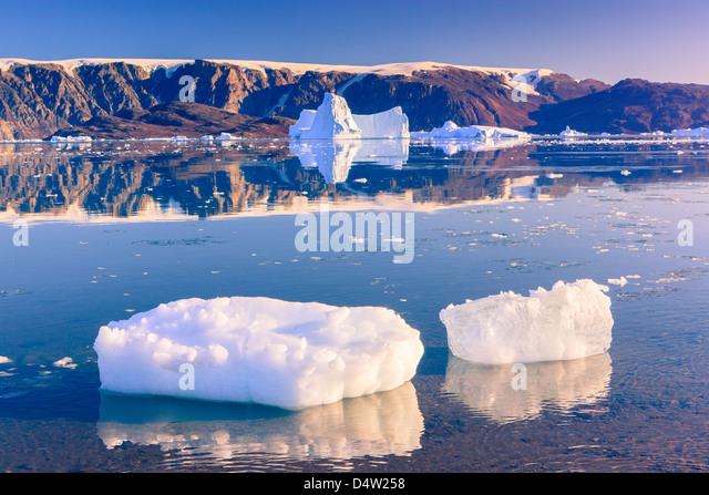 Cruising between the icebergs at Røde Ø, Scoresbysund, Greenland - Stock Image