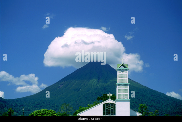 Costa Rica Fortuna de San Carlos Volcano Arenal cloud at the top  - Stock Image