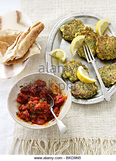 courgette fritters Harissa flat bread - Stock Image