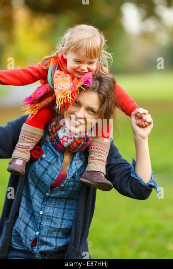 Mother and daughter in the park - Stock Image