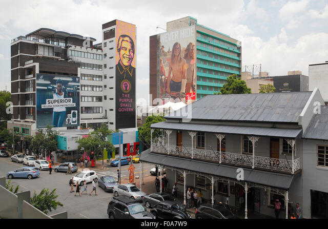 South Africa, Johannesburg. Mandela advert and the colonial era architecture. - Stock Image