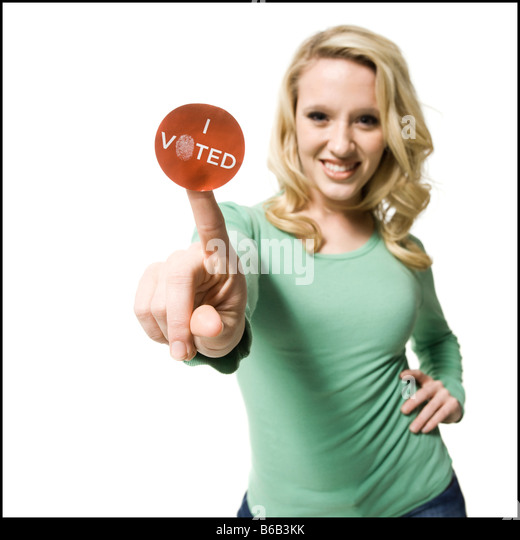 woman with an i voted sticker - Stock Image