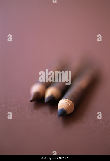 Eyebrow pencils, close-up, blurred - Stock Image