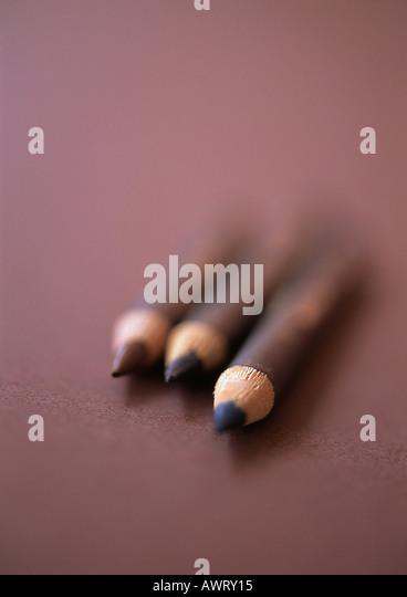 Eyebrow pencils, close-up, blurred - Stock Image