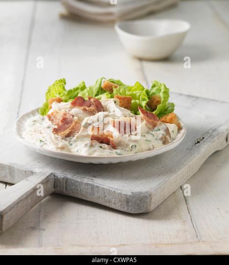 Plate of chicken bacon caesar salad - Stock Image