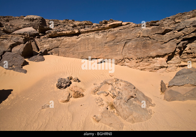 Distant shot of Winklers famous Rock-Art site 26 in Wadi Abu Wasil showing sand dune in the Eastern Desert of Egypt. - Stock Image