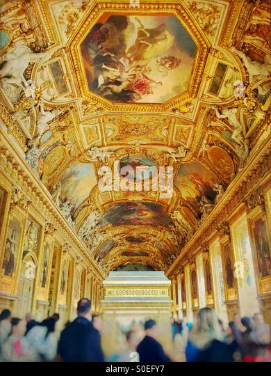 The golden Galerie d'Apollon famous for its high vaulted ceilings with painted decorations and stucco sculptures. - Stock Image