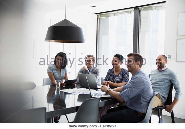 Smiling business people in conference room meeting - Stock-Bilder