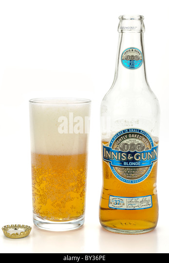 Innis and Gunn Blonde beer and a half full  glass - Stock Image