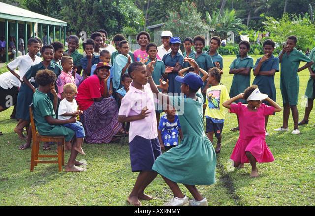 South Pacific Fiji Vitu Levu school class, kids dancing and singing outdoors - Stock Image