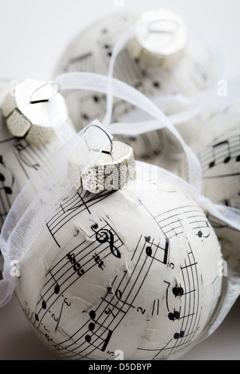 Christmas baubles made from old music book - Stock Image