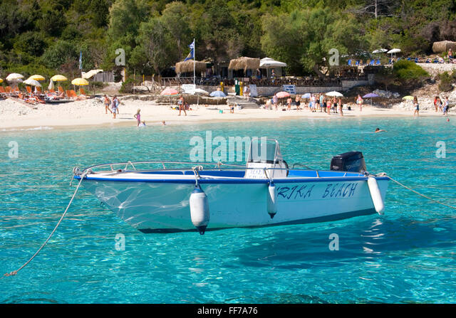 Antipaxos, Ionian Islands, Greece. Boat moored in clear turquoise water off Vrika Beach. - Stock Image