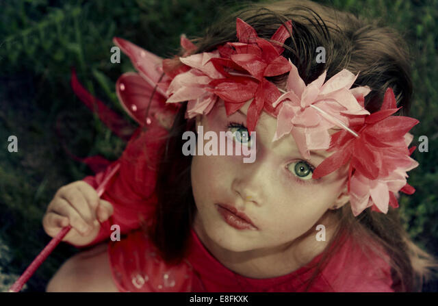 Girl dressed in pink fairy costume - Stock Image