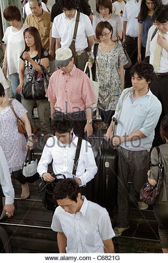 Japan Tokyo Ryogoku JR Ryogoku Station Asian man men woman women commuters passengers descending steps stairs group - Stock Image