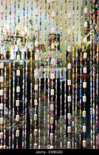 Beaded curtain across grocery in Lucca, Italy - Stock Image