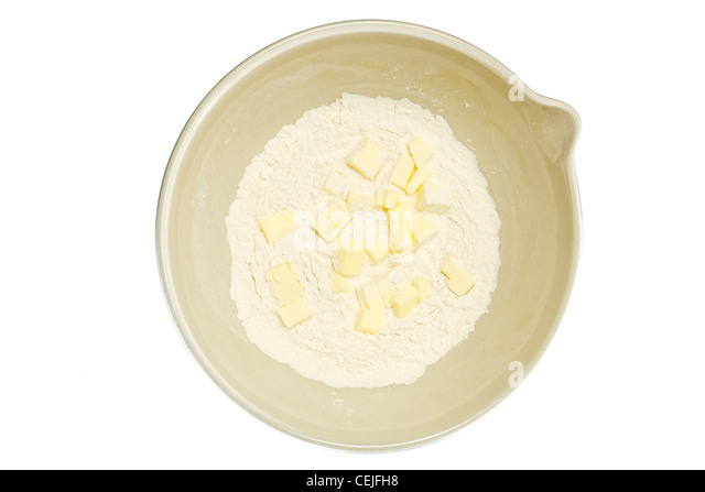 flour and butter in mixing bowl - Stock Image