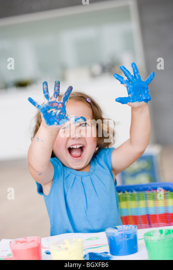 young girl playing with colours - Stock Image