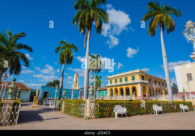 Cuba, Sancti Spiritus Province, Trinidad. Plaza filled with palm trees. - Stock Image
