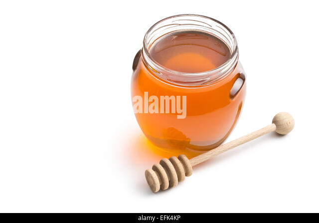 honey in a jar on white background - Stock Image