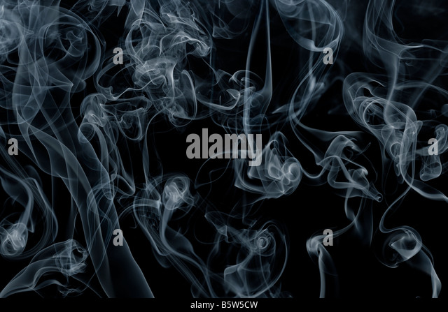 Smoke swirling against a black background - Stock-Bilder