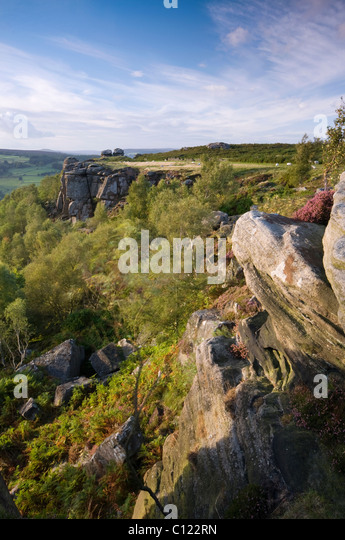 Froggatt Edge, Derbyshire with flowering heather in late afternoon light, September 2010 - Stock Image