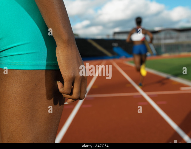 Female runners on race track - Stock Image