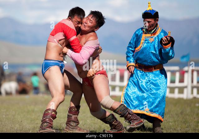 Mongolian wrestling in Naadam festival in Tsagaannuur, Khövsgöl, Mongolia - Stock Image