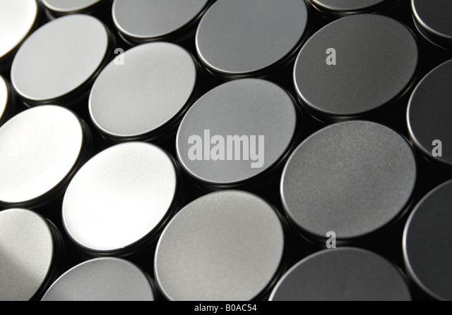 Jar lids arranged in pattern, close-up, full frame - Stock Image