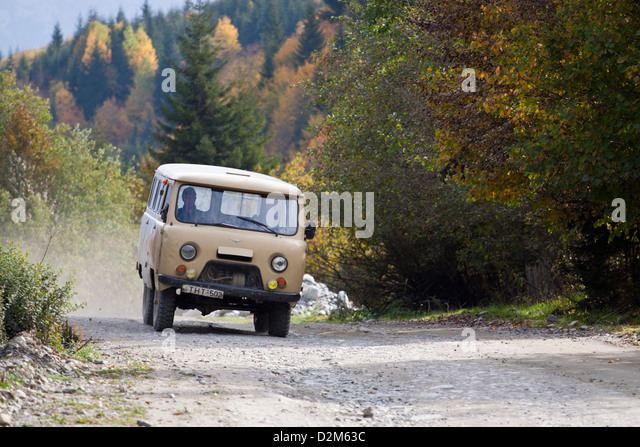 Old Russian UAZ 452 minivan on a dirt track in Georgia - Stock Image