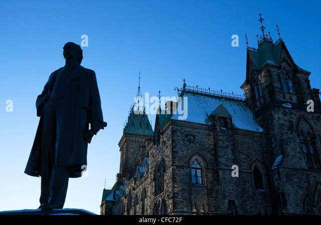 Statue of Sir Wilfrid Laurier and Parliament Buildings, Ottawa, Ontario, Canada - Stock Image