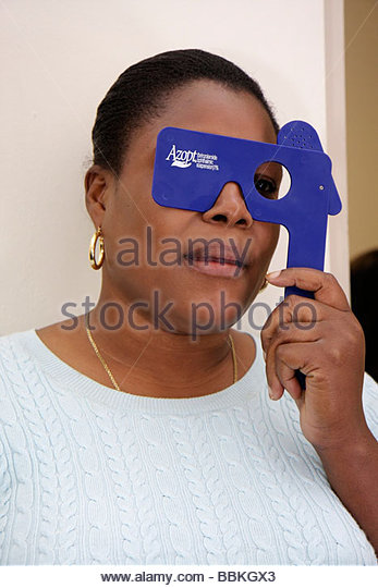 Miami Florida Liberty City Jessie Trice Community Health Center fair free care exam volunteer Black woman ophthalmology - Stock Image