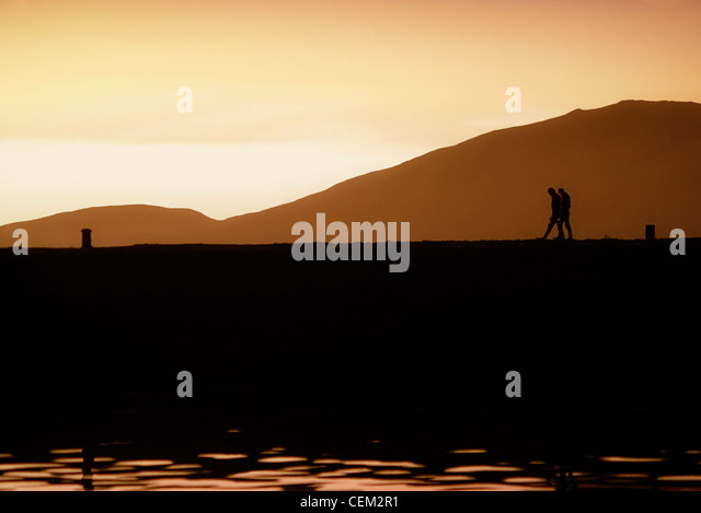 People Walking Along A Quay, Ireland - Stock Image
