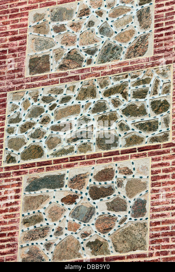Abstract art on public brick wall in Toledo, Spain - Stock Image