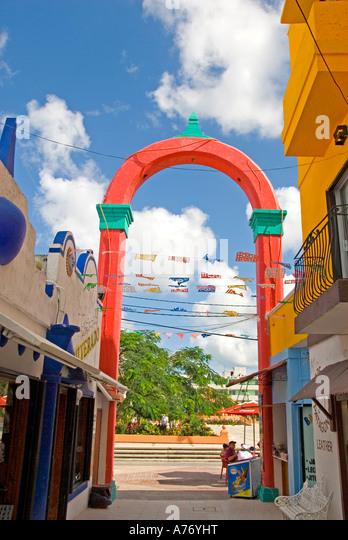 Cozumel Mexico San Miguel town shopping plaza off main square Parque Benito Juarez La Plaza red arch - Stock Image