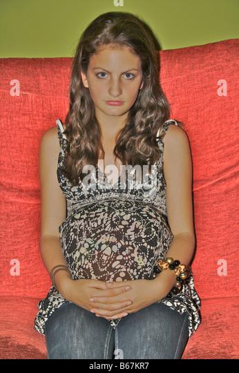 Pregnant teenager looking at camera - Stock-Bilder