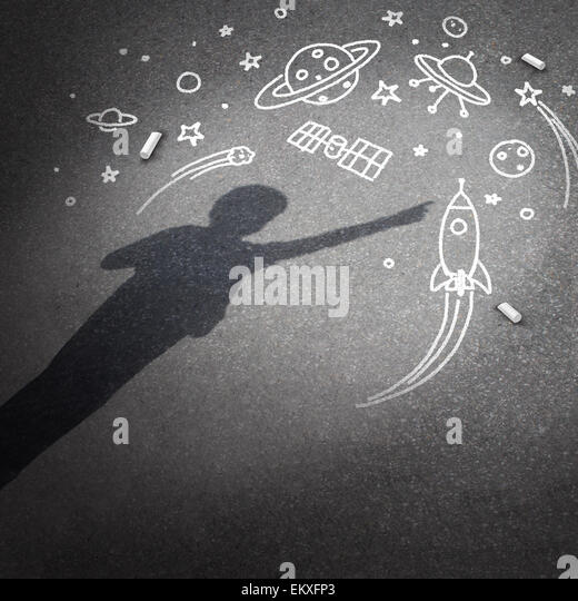 Child space dream as a childhood imagination concept with a cast shadow of a kid dreaming of being an astronaut - Stock Image
