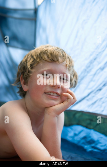 Portrait of a young boy in a tent - Stock-Bilder