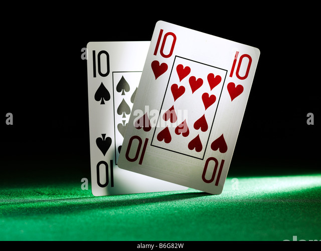 two playing cards the ten of clubs and the 10 of hearts - Stock Image